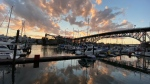View of boats docked at Burrard Civic Marina under the Granville Bridge at sunset captured by Cecile in October 2020 (Submitted)