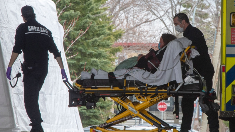 Ambulance workers bring a patient to the emergency unit at Lasalle Hospital, Monday April 27, 2020 in Montreal.THE CANADIAN PRESS/Ryan Remiorz