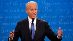 Democratic presidential candidate former U.S. Vice President Joe Biden speaks during the second and final presidential debate Thursday, Oct. 22, 2020, at Belmont University in Nashville, Tenn., with President Donald Trump. (AP Photo/Julio Cortez)