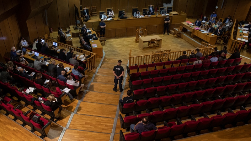 A view of the court during the sentencing announcement of the Golden Dawn trial, in Athens, Wednesday, Oct. 14, 2020. (AP Photo/Petros Giannakouris)