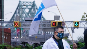 Health-care workers block access to the Jacques Cartier bridge during in protest over stalled contact negotiations with the provincial government in Montreal, on Monday, October 19, 2020. THE CANADIAN PRESS/Paul Chiasson