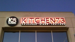 Kitchen73's owner is irate after the Office quebecois de la langue francaise sent the establishment a letter saying their exterior signage did not conform with Quebec's language laws. SOURCE: Kitchen73 / Facbook