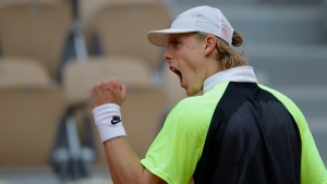Canada's Denis Shapovalov clenches his fist after scoring a point against Spain's Roberto Carballes Baena in the second round match of the French Open tennis tournament at the Roland Garros stadium in Paris, France, Thursday, Oct. 1, 2020. (AP Photo/Christophe Ena)