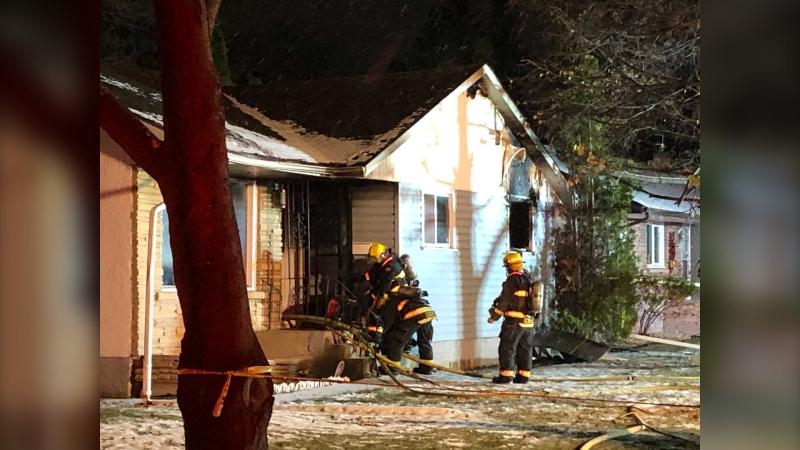 Winnipeg firefighters respond to a house fire on Ashton Avenue on October 23, 2020 (CTV News Photo Ken Gabel)