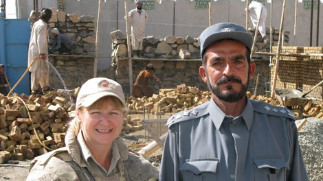 Corrections Canada official Gail Latouche and Col. Abdullah Khan Bawar, the director of Sarposa prison in Kandahar, Afghanistan, stand in front of a portion of the prison which is being rebuilt in this Oct. 3, 2009 photo. (THE CANADIAN PRESS/Bill Graveland)
