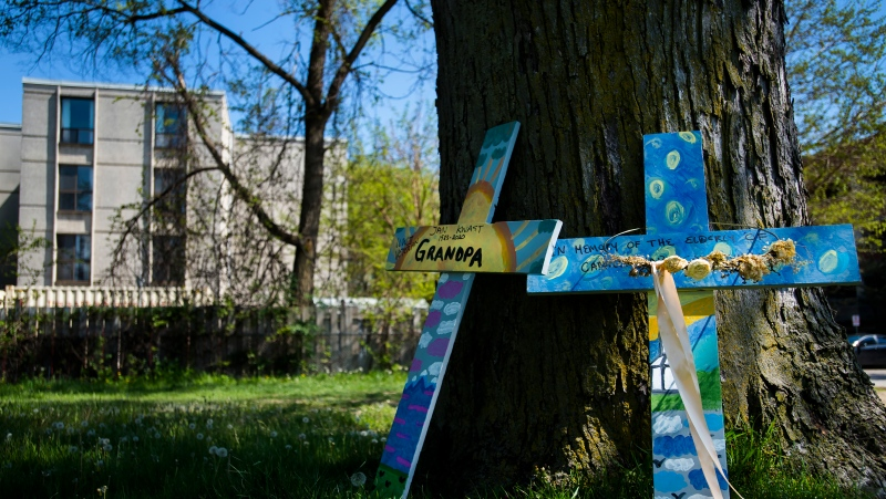 Crosses are displayed outside the Camilla Care Community centre marking the deaths of multiple people that occurred during the COVID-19 pandemic in Mississauga, Ont., on Tuesday, May 26, 2020. THE CANADIAN PRESS/Nathan Denette