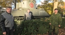From left, retired lieutenant-colonel Ian Haley, retired lieutenant-colonel Joe Murray, and current 1st Hussars commanding officer Lt.-Col. Allan Finney, stand in front of the Holy Roller Tank in London, Ont.'s Victoria Park on Friday, Oct. 23, 2020. (Sean Irvine / CTV News)