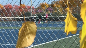 Unusually warm temperatures on Fri., Oct. 23, 2020, had some folks hitting the tennis courts in Barrie, Ont. (KC Colby/CTV News)