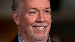 NDP Leader John Horgan smiles as he attends a campaign stop in New Westminster, B.C. Friday, October 23, 2020. (THE CANADIAN PRESS/Jonathan Hayward)