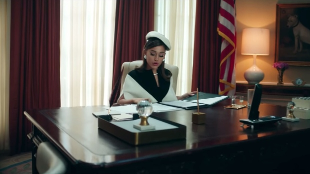 "Ariana Grande makes an impressive president in the video for her new single, ""Positions."" (Source: Ariana Grande, YouTube)"
