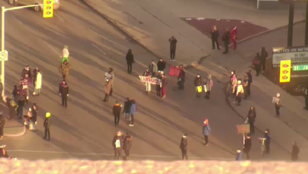 Protesters gathered at the intersection of Portage Avenue and St. James Street Friday evening.
