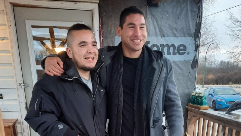 Devon Henderson (left) greets Johnathan Meikle (right) after being released from jail in The Pas on Oct. 23, 2020. Henderson stabbed Meikle in the leg two years earlier, and has been in the restorative justice system since. (Submitted: Darin Hart)