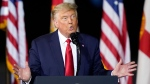 President Donald Trump speaks at a campaign rally in Pensacola, Fla., Friday, Oct. 23, 2020. (AP Photo/Gerald Herbert)