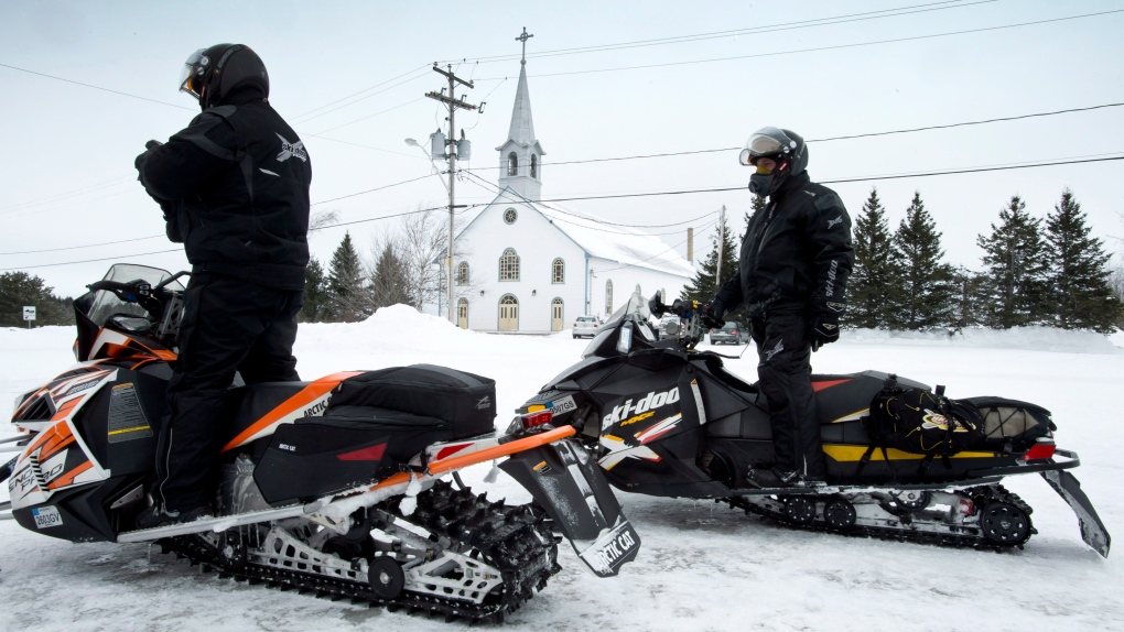 American tourists on snowmobiles