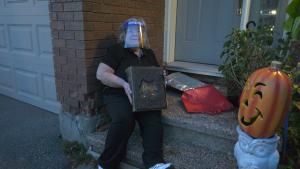 Bonnie Donovan holds a bible that was found in Calgary, but belonged to an Ottawa family.  (Shaun Vardon/CTV News Ottawa)