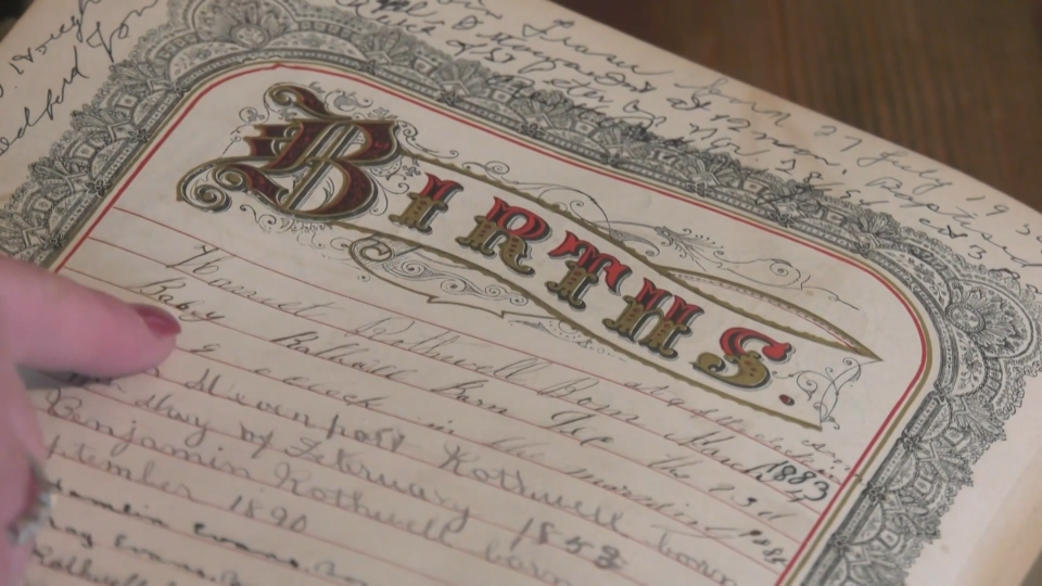 Bonnie Gerard discovered this bible while assisting a client in Calgary, and discovered it belonging to an Ottawa family. (Shaun Vardon/CTV News Ottawa)