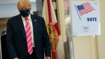 President Donald Trump walks to speak with reporters after voting at the Palm Beach County Main Library, Saturday, Oct. 24, 2020, in West Palm Beach, Fla. (AP Photo/Evan Vucci)