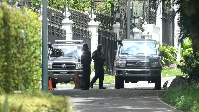 Members of the SEBIN intelligence police guard the perimeters of the Spanish ambassador's residence where opposition leader Leopoldo Lopez had been a guest after participating in a failed military uprising, in Caracas, Venezuela, Saturday, Oct. 24, 2020. (AP Photo/Matias Delacroix)