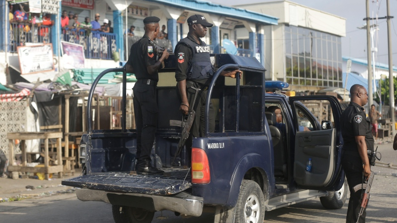 Police officers patrol near the Lekki toll gate in Lagos, Nigeria, Wednesday Oct. 21, 2020. ( AP Photo/Sunday Alamba)