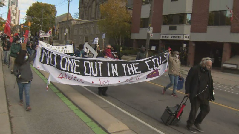 Housing advocates gathered in downtown Toronto to rally for some vacant properties to be developed into affordable social housing.