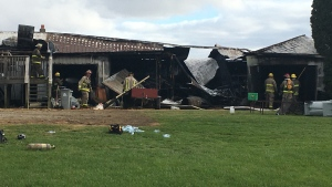House fire on Melbourne Road near Strathroy, Ont. on Oct. 24, 2020. (Brent Lale/CTV London)