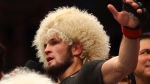 Russian UFC fighter Khabib Nurmagomedov, speaks after wining against UFC fighter Dustin Poirier, of Lafayette, La., during Lightweight title mixed martial arts bout at UFC 242, in Yas Mall in Abu Dhabi, United Arab Emirates, Saturday , Sept.7 2019. (AP Photo/ Mahmoud Khaled)
