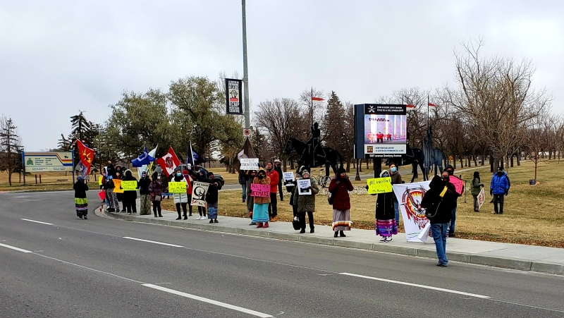 Nearly 50 people gathered in front of the RCMP Heritage Centre on Saturday to protest the treatment of Indigenous people by the RCMP. (Mick Favel/CTV News)