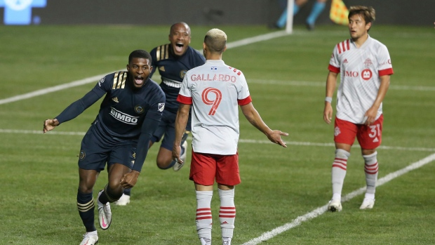 Mark McKenzie, left, of the Philadelphia Union celebrates after his goal against Toronto FC during the first half of an MLS match Saturday, Oct. 24, 2020, in Chester, Pa. (Charles Fox/The Philadelphia Inquirer via AP)
