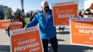 NDP Leader John Horgan greets supporters on election day in Vancouver, Saturday, Oct. 24, 2020. (THE CANADIAN PRESS/Jonathan Hayward)