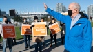 NDP Leader John Horgan greets supporters on election day in Vancouver, Saturday, October 24, 2020. THE CANADIAN PRESS/Jonathan Hayward