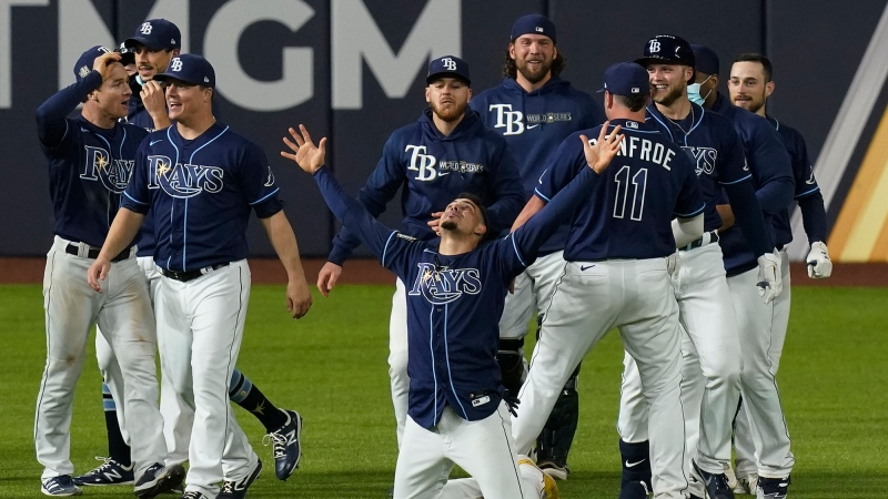 Tampa Bay Rays celebrate their win against the Los Angeles Dodgers in Game 4 of the World Series Saturday, Oct. 24, 2020, in Arlington, Texas. (AP Photo/Eric Gay)