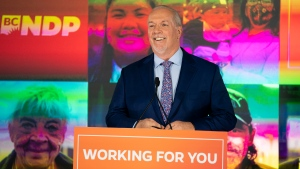 NDP Leader John Horgan celebrates his election win in the British Columbia provincial election in downtown Vancouver, B.C., Saturday, Oct. 24, 2020. (THE CANADIAN PRESS / Jonathan Hayward)