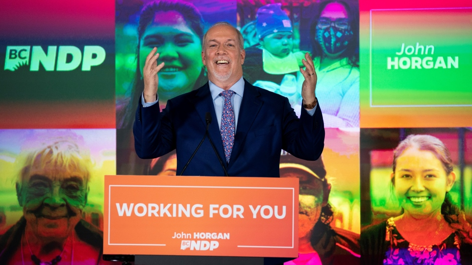 NDP Leader John Horgan celebrates his election win in the British Columbia provincial election in downtown Vancouver, B.C., Saturday, Oct. 24, 2020. THE CANADIAN PRESS/Jonathan Hayward