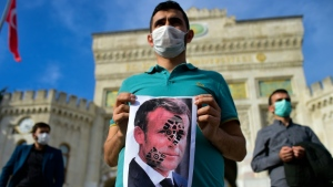 Protesters took to the streets of Istanbul Sunday to voice their displeasure against French President Emmanuel Macron's recent comments on Islam. (AFP)