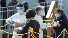 People lineup at a COVID-19 testing clinic Tuesday, October 6, 2020 in Montreal. Quebec reported a record 1,364 new cases of the virus.THE CANADIAN PRESS/Ryan Remiorz