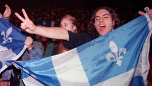 A Yes supporter holding a Quebec flag chants nationalist slogans prior to a concert of Quebec rock stars in support of sovereignty in Montreal Friday Sept. 29, 1995. Sunday marks the 10th anniversary of the Quebec sovereignty referendum vote that was held on Oct. 30, 1995. THE CANADIAN PRESS/Paul Chiasson