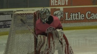 Youth hockey player making saves for cancer care