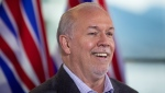 B.C. Premier-elect John Horgan smiles during a post-election news conference, in Vancouver, on Sunday, October 25, 2020. THE CANADIAN PRESS/Darryl Dyck