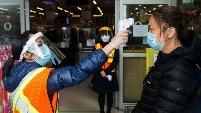 People get their temperatures tested at the T&T grocery store to help curb to spread of COVID-19 in Markham, Ont., on Monday, April 20, 2020. THE CANADIAN PRESS/Nathan Denette