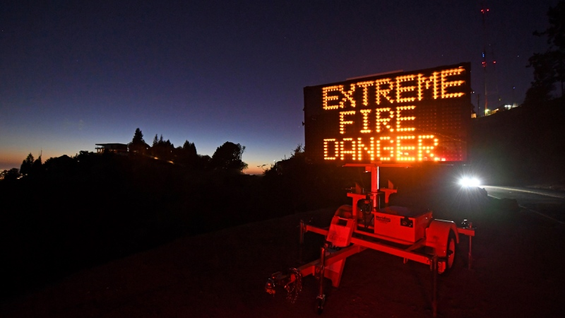 A roadside sign warns motorists of extreme fire danger on Grizzly Peak Boulevard, in Oakland, Calif., Sunday, Oct. 25, 2020. (Jose Carlos Fajardo/Bay Area News Group via AP)