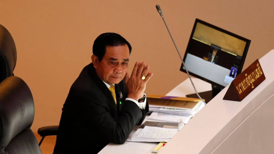 Thailand Prime Minister Prayuth Chan-ocha looks on during the special session at the parliament house in Bangkok, Thailand, Monday, Oct. 26, 2020. (AP Photo/Sakchai Lalit)