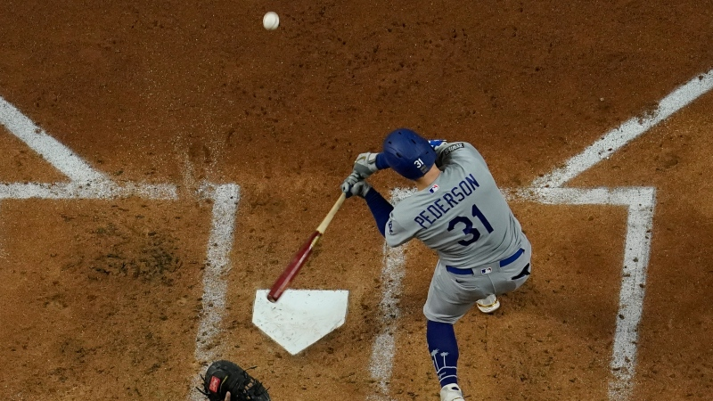Los Angeles Dodgers' Joc Pederson hits a home run against the Tampa Bay Rays during the first inning in Game 5 of the baseball World Series Sunday, Oct. 25, 2020, in Arlington, Texas. (AP Photo/David J. Phillip)