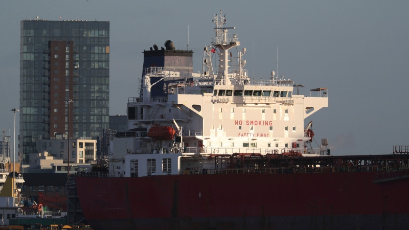 The Nave Andromeda oil tanker is docked next to the Queen Elizabeth II Cruise Terminal in Southampton, England, on Oct. 26, 2020.  (Andrew Matthews/PA Wire via AP)