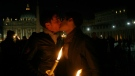Two men kiss outside St. Peter's Square at the Vatican during a candle-lit demonstration for gay rights, on Dec. 6, 2008. (Alessandra Tarantino / AP)
