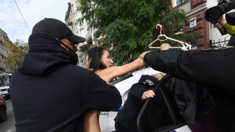 Police officers quickly detained the naked Femen activist. (AFP)