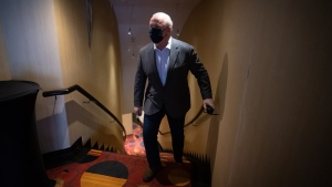 B.C. Premier-elect John Horgan arrives for a post-election news conference, in Vancouver, on Sunday, October 25, 2020. THE CANADIAN PRESS/Darryl Dyck