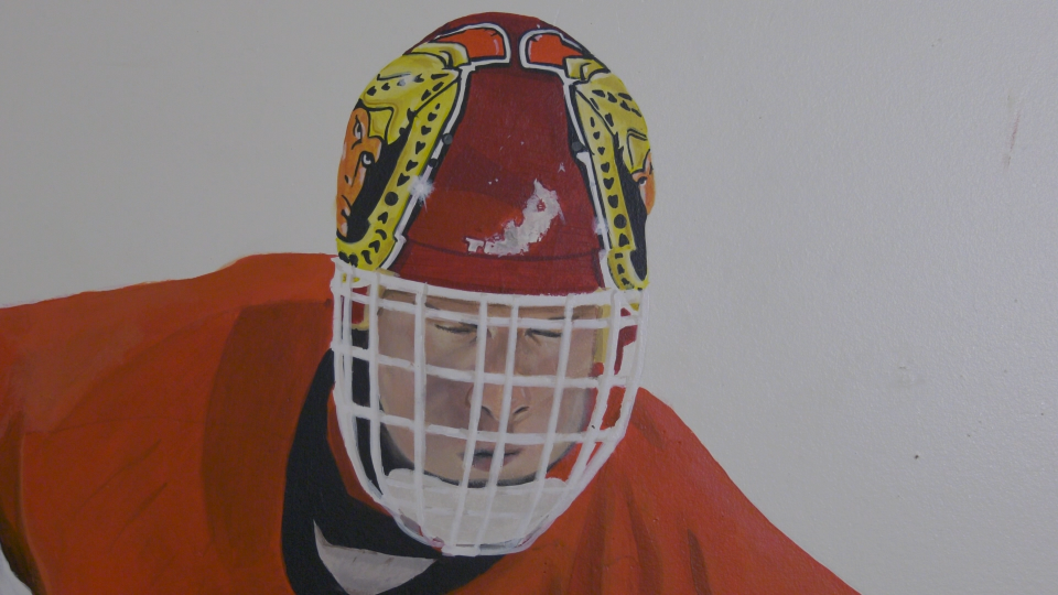 The Dominik Hasek mural on the wall of Garrett McCallum's old bedroom. It was painted by artist Michael O'Shea. (Nate Vandermeer / CTV News Ottawa)