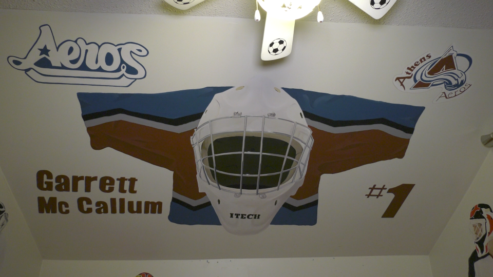 A painting of Garrett McCallum's old Athens Aeros jersey, on the sloped ceiling of his childhood bedroom. (Nate Vandermeer / CTV News Ottawa)