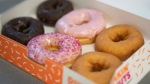 A box of Dunkin' Donuts is displayed in New York, on Feb. 6, 2019. (Mark Lennihan / AP)