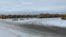 Southland Transportation's fleet of school buses returned to the yard in Cochrane following a Monday morning bomb threat over the radio system